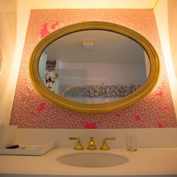 Hello Kitty Band-Aids add a pop of color to the wall in the master bathroom.