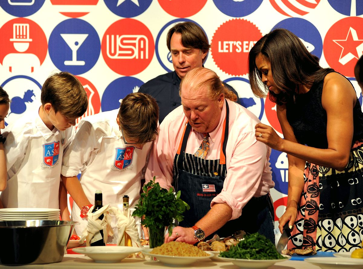 First Lady Michelle Obama, with chefs Mario Batali and John Besh at the Milan Expo. Photo: Pier Marco Tacca/Getty Images