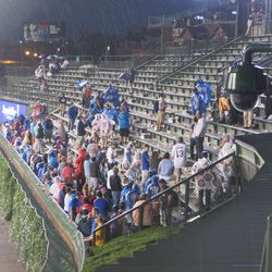 8:30 p.m. Fans watching the Blackhawks game in left field -