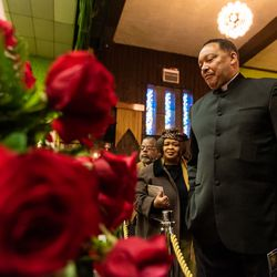 Pastor James Bryson pays his respects to Pastor Maceo L. Woods, during the wake and funeral for Woods at Christian Tabernacle Church, Saturday, Jan. 18, 2020, in Chicago.