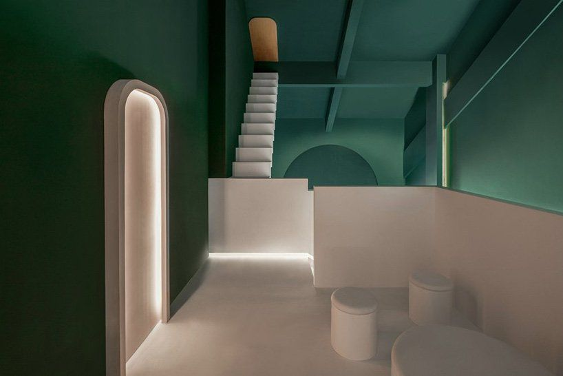 Forest green hallway with white stairs