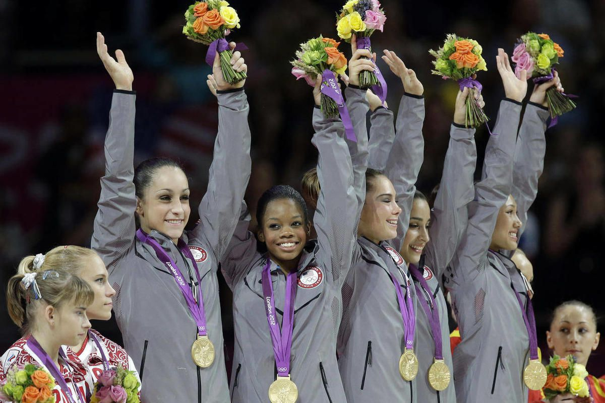 U.S. gymnasts, top left to right, Jordyn Wieber, Gabrielle Douglas, McKayla Maroney, Alexandra Raisman and Kyla Ross raise their hands and celebrate during the medal ceremony of the Artistic Gymnastics women's team final at the 2012 Summer Olympics, Tuesd