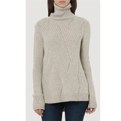 """<b>Vince</b> Ribbed Turtleneck in Almondine, <a href=""""http://www.vince.com/ribbed-turtleneck-/invt/vnv170275216&bklist=icat,4,shop,women,wsweaters"""">$355</a>"""