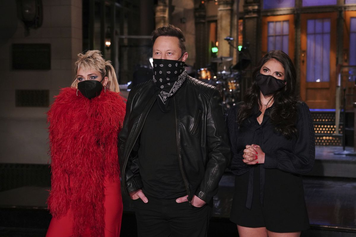 """Musical guest Miley Cyrus, host Elon Musk, and Cecily Strong during promos in Studio 8H for """"Saturday Night Live."""""""
