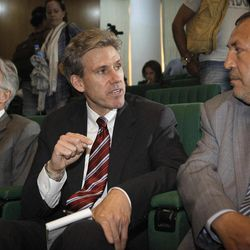 In this photo taken Monday, April 11, 2011, then U.S. envoy Chris Stevens, center, accompanied by British envoy Christopher Prentice, left, speaks to Council member for Misrata Dr. Suleiman Fortia, right, at the Tibesty Hotel where an African Union delegation was meeting with opposition leaders in Benghazi, Libya. Libyan officials say the U.S. ambassador and three other Americans have been killed in an attack on the U.S. consulate in the eastern city of Benghazi by protesters angry over a film that ridiculed Islam's Prophet Muhammad.