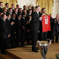President Barack Obama receives a team jersey from Real Salt Lake co-owner Dave Checketts Friday at the White House during ceremony honoring the MLS Cup champions. Real Salt Lake plays DC United Saturday.