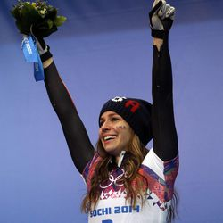 Noelle Pikus-Pace of the United States cries during the flower ceremony after winning the silver medal during the women's skeleton competition at the 2014 Winter Olympics, Friday, Feb. 14, 2014, in Krasnaya Polyana, Russia.