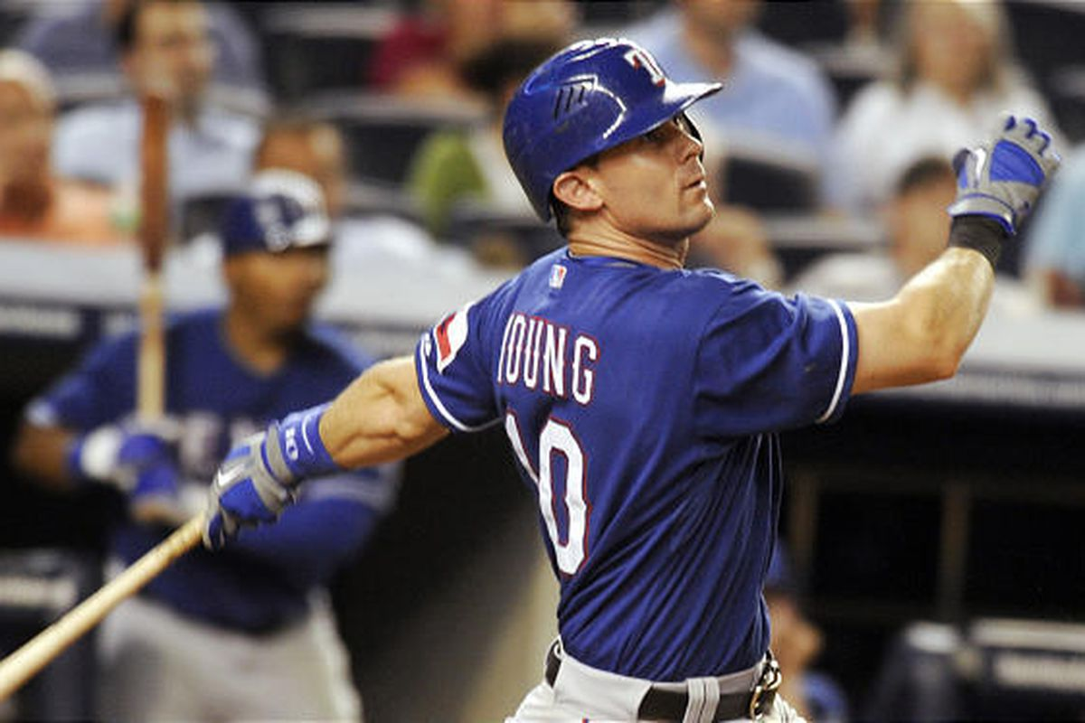 Texas Rangers' Michael Young hits a two-run home run in the seventh inning to put the Rangers ahead 10-5.