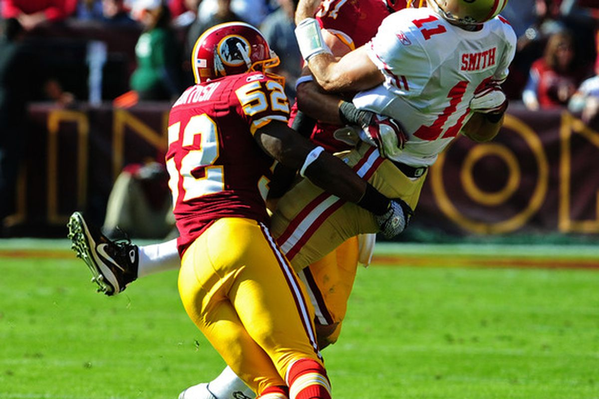 LANDOVER, MD - NOVEMBER 6: Alex Smith #11 of the San Francisco 49ers is sacked by Rocky McIntosh #52 and Ryan Kerrigan #91 of the Washington Redskins at FedEx Field on November 6, 2011 in Landover, Maryland. (Photo by Scott Cunningham/Getty Images)
