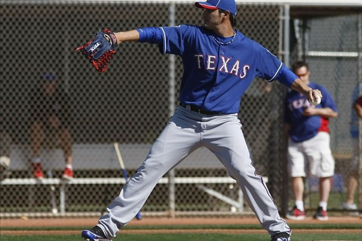 February 26, 2012; Surprise, AZ, USA; Texas Rangers starting pitcher Martin Perez (33) during camp at Surprise Stadium .  Mandatory Credit: Rick Scuteri-US PRESSWIRE