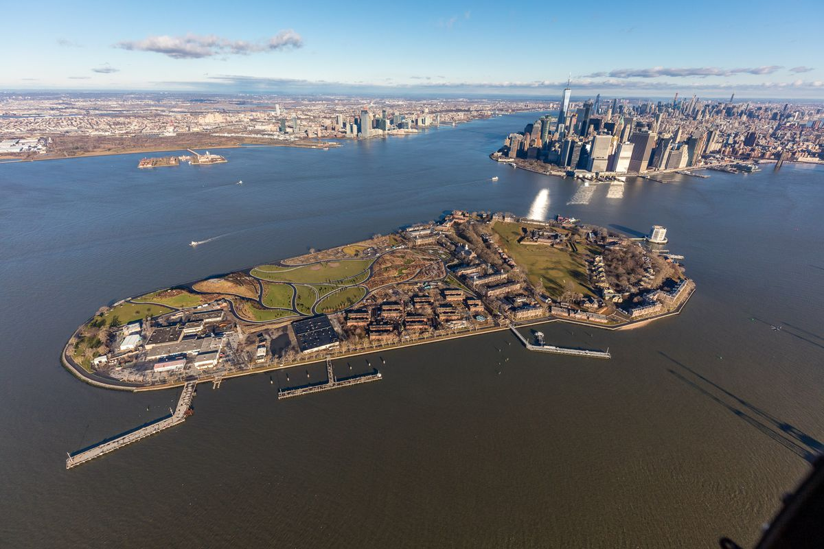 An aerial view of an island surrounded by water in New York Harbor.