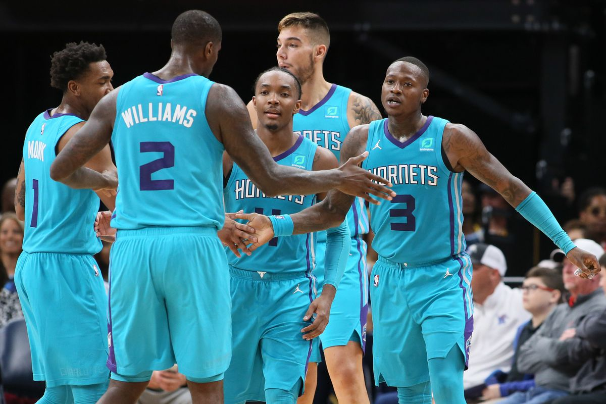 Charlotte Hornets guards Devonte Graham and Terry Rozier III celebrate with teammates after scoring against the the Memphis Grizzlies at FedExForum.