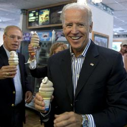 Vice President Joe Biden stops for an ice cream cone at a Dairy Queen, Saturday, Sept. 8, 2012, in Nelsonville, Ohio, with former Ohio Gov. Ted Strickland, right.