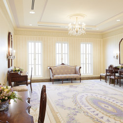 The bride's room in the Mesa Arizona Temple. A crystal chandelier, decorative friezes just below the crown molding, mahogany-framed mirrors from Vietnam and custom-painted walls are some of the features designed to create a warm and calm ambiance.