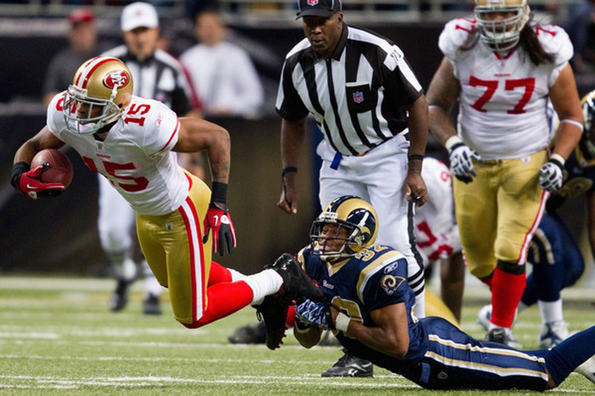 Bradley Fletcher #32 of the St. Louis Rams tackles Michael Crabtree #15 of the San Francisco 49ers at the Edward Jones Dome on December 26 2010 in St. Louis Missouri. The Rams beat the 49ers 25-17. (Photo by Dilip Vishwanat/Getty Images)