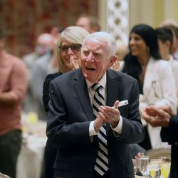 Attendees applaud Utah Sports Hall of Fame honorees at a banquet at the Little America Hotel in Salt Lake City on Monday, Sept. 20, 2021.