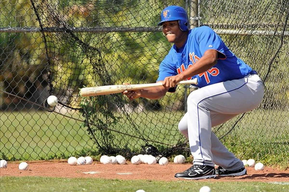 Jeurys Familia practices his bunting