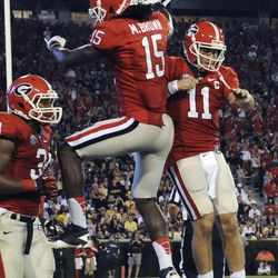 Georgia wide receiver Marlon Brown (15) quarterback Aaron Murray (11) celebrate a during the third quarter of an NCAA college football game against Vanderbilt , Saturday, Sept. 22, 2012, in Athens, Ga. Georgia won 48-3.