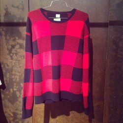 Don't be fooled by the simplicity of this E. Tautz sweater - it's actually a hand intarsia knit and costs $1,800.