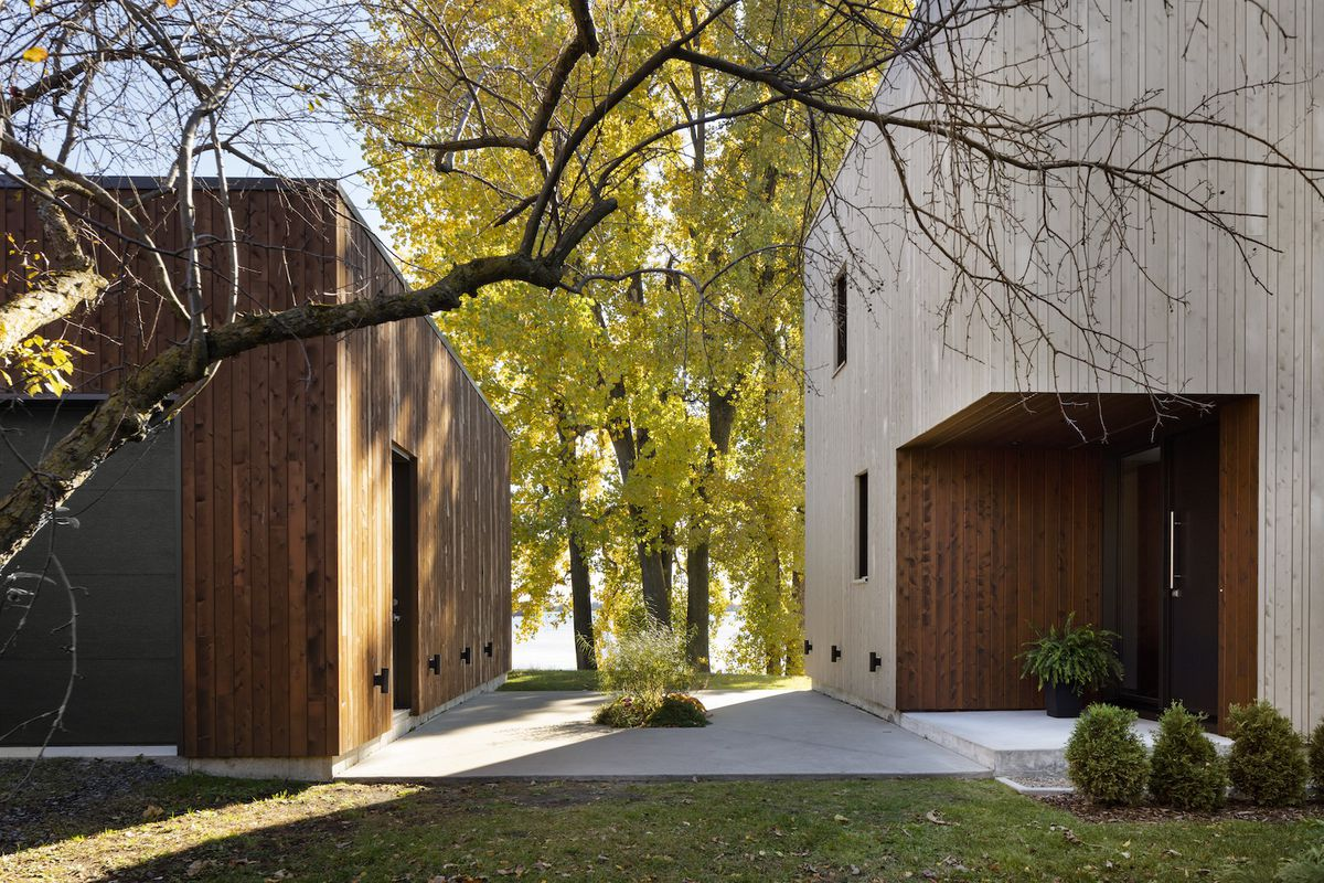 Two volumes side by side, separated by small concrete courtyard.