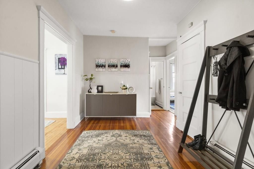 A large foyer with a closed front door.