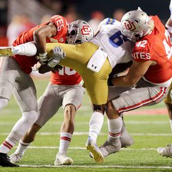 Utah Utes defensive back Vonte Davis (22) and Utah Utes defensive end Mika Tafua (42) bring down UCLA Bruins running back Martell Irby (6) as Utah and UCLA play a college football game in Salt Lake City at Rice-Eccles Stadium on Saturday, Nov. 16, 2019. Utah won 49-3.