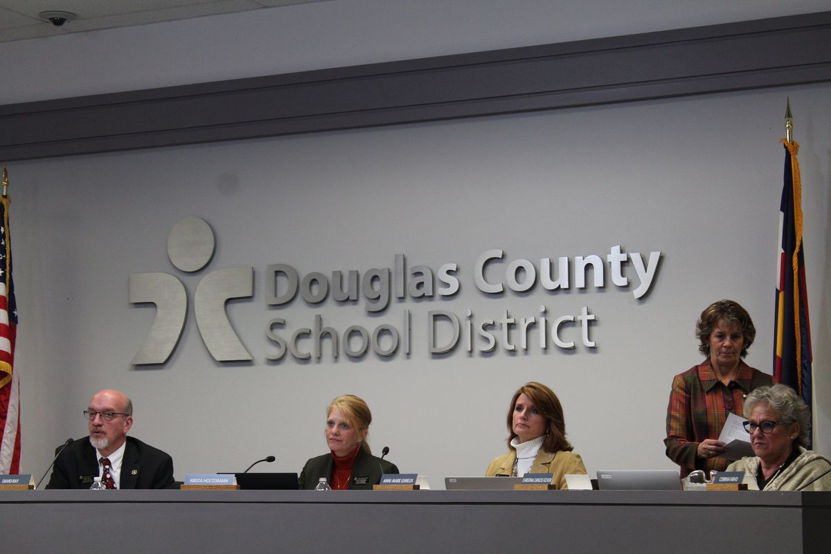 The Douglas County school board on Monday voted to end the district's voucher program and directed the district to seek an end to the protracted legal case. (Nic Garcia/Chalkbeat)