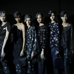 Model wear creations part of the Giorgio Armani women's Spring-Summer 2013 collection that was presented in Milan, Italy, Sunday, Sept. 23, 2012.