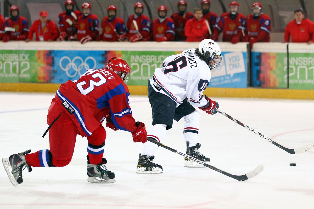 Nick Schmaltz carries the puck up ice in a game against Russia.