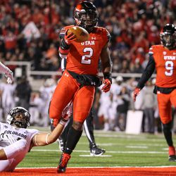 Utah Utes running back Zack Moss (2) runs for a touchdown, putting the Utes up 7-0 over the Colorado Buffaloes after the PAT, at Rice-Eccles Stadium in Salt Lake City on Saturday, Nov. 25, 2017.