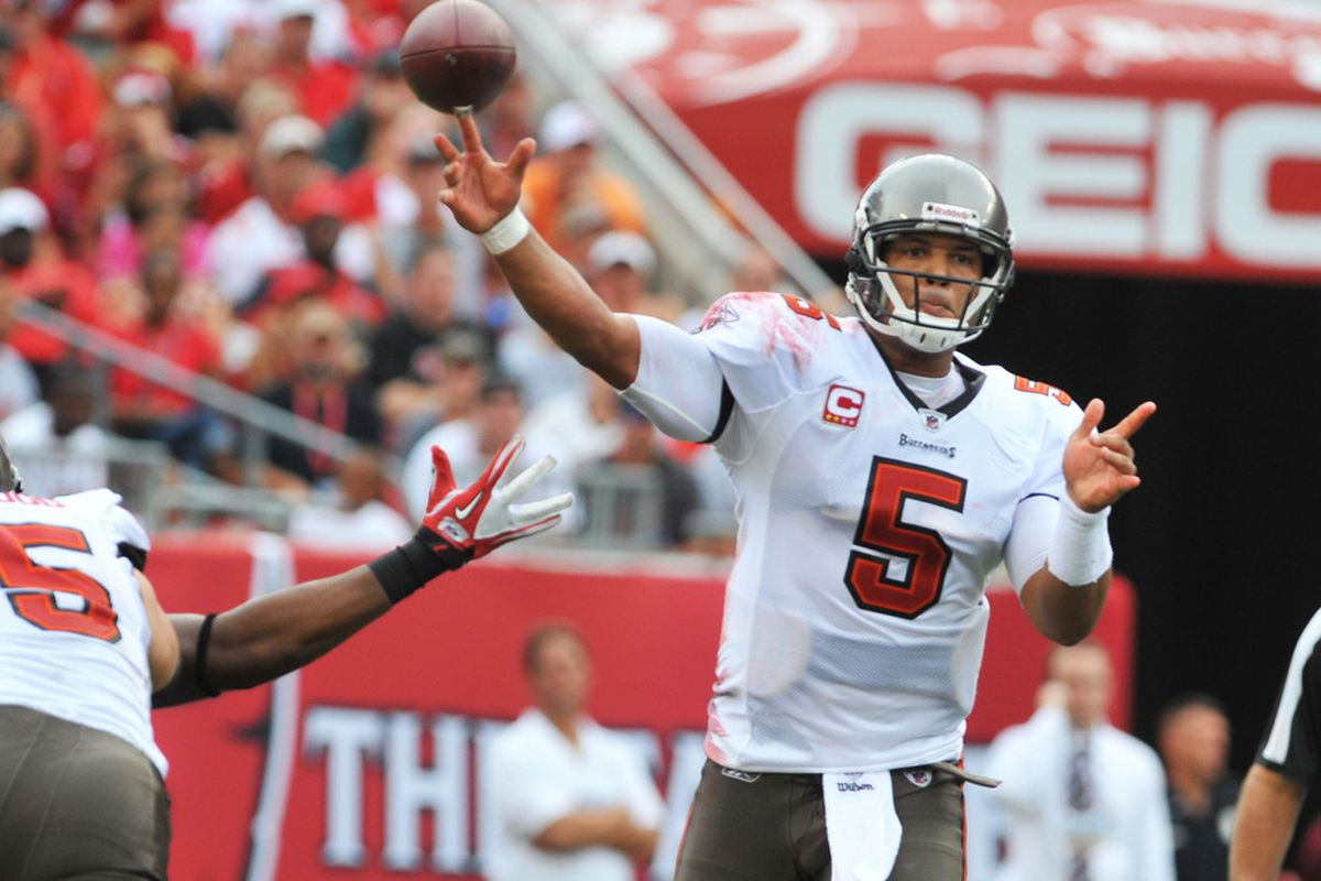 TAMPA, FL - SEPTEMBER 25:  Quarterback Josh Freeman #5 of the Tampa Bay Buccaneers releases a pass against the Atlanta Falcons  September 25, 2011 at Raymond James Stadium in Tampa, Florida. (Photo by Al Messerschmidt/Getty Images)