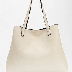 """Vegan, reversible and oversized. <a href=""""http://www.urbanoutfitters.com/urban/catalog/productdetail.jsp?id=27953686&parentid=W_ACC_BAGS&color=001"""">Oversized Tote</a>, $59 at Urban Outfitters."""