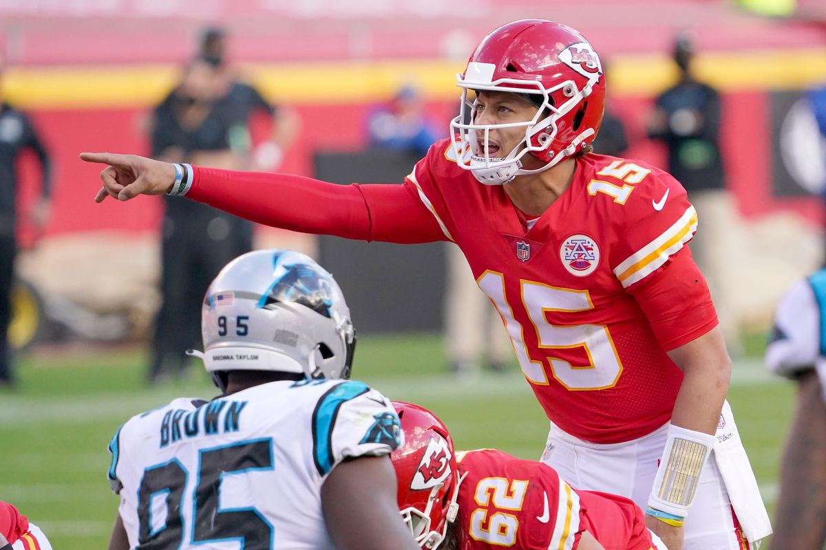 Kansas City Chiefs quarterback Patrick Mahomes (15) gestures at the line of scrimmage during the second half against the Carolina Panthers at Arrowhead Stadium.