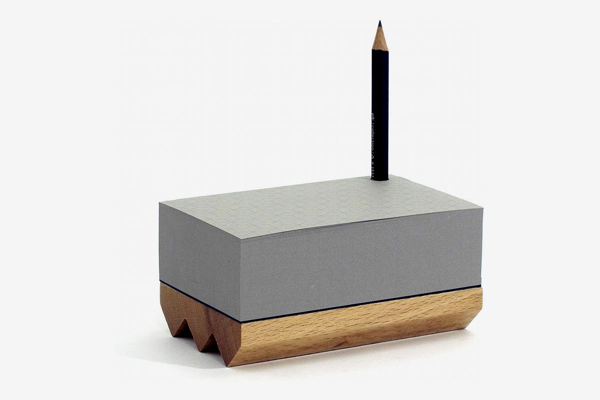 A gray and wood box has a slot for a pencil to stand straight up.