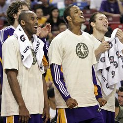 Los Angeles Lakers' Kobe Bryant, left, Trevor Ariza, center, and Luke Walton celebrate after the Lakers scored late in the fourth quarter of their 122-104 win over the Sacramento Kings in an NBA basketball game played in Sacramento, Calif., Tuesday, April 7, 2009.
