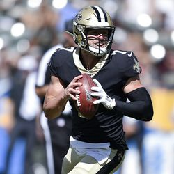 New Orleans Saints quarterback Taysom Hill looks to pass during the second half of a preseason NFL football game against the Los Angeles Chargers Sunday, Aug. 18, 2019, in Carson, Calif.