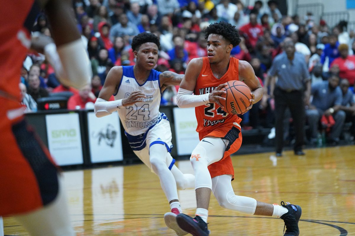Young's Tyler Beard (24) blows past Curie's Ramean Hinton (23).