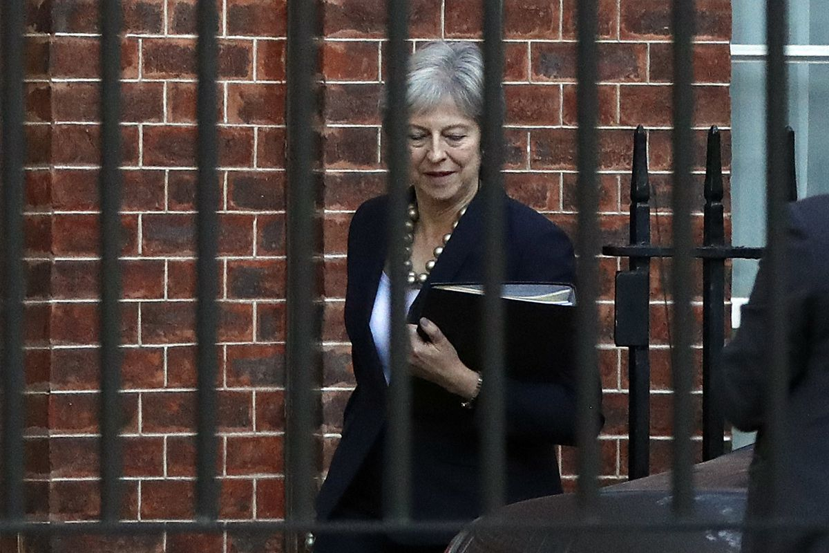 Britain's Prime Minister Theresa May leaves 10 Downing Street to give a statement to parliament in London, Monday, Oct. 22, 2018. May is urging Parliament to support her as Brexit looms, saying a divorce deal with the European Union is 95 percent complete