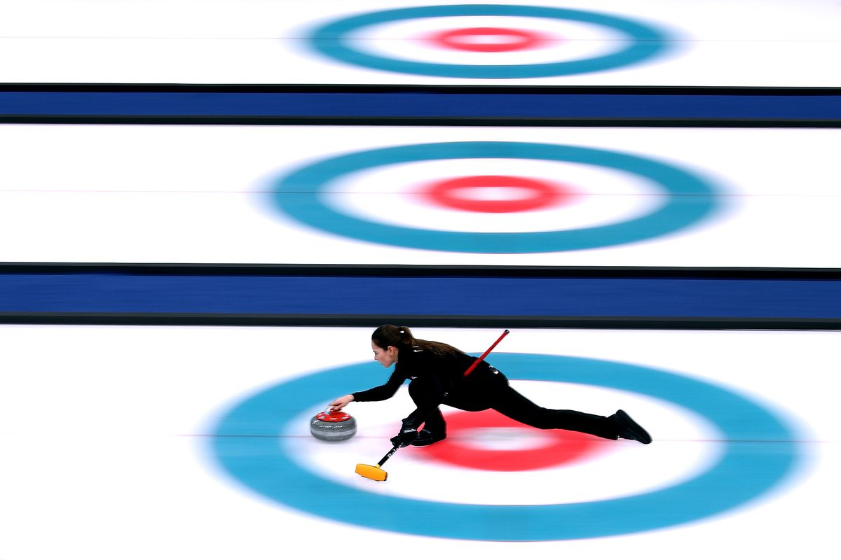 A curling athlete participating at the olympics