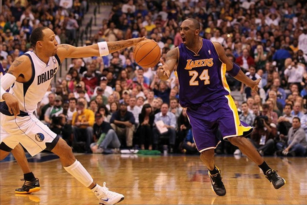Feb 22, 2012; Dallas, TX, USA; Dallas Mavericks forward Shawn Marion (0) steals the ball from Los Angeles Lakers guard Kobe Bryant (24) in the thrid quarter at American Airlines Center.  Mandatory Credit: Matthew Emmons-US PRESSWIRE