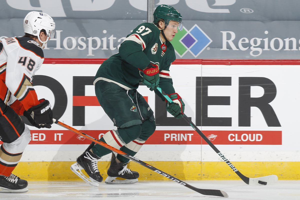 Kirill Kaprizov #97 of the Minnesota Wild skates with the puck while Isac Lundestrom #48 of the Anaheim Ducks defends during the game at the Xcel Energy Center on May 8, 2021 in Saint Paul, Minnesota.