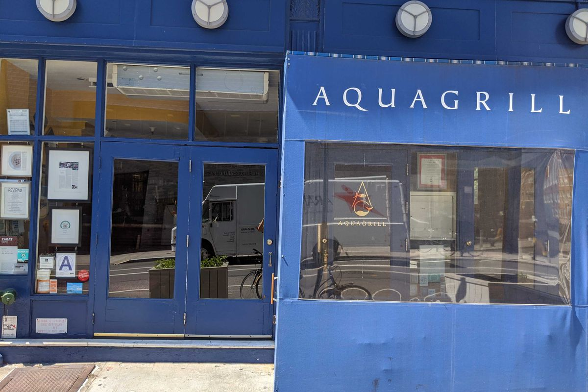 The blue storefront of Aquagrill restaurant