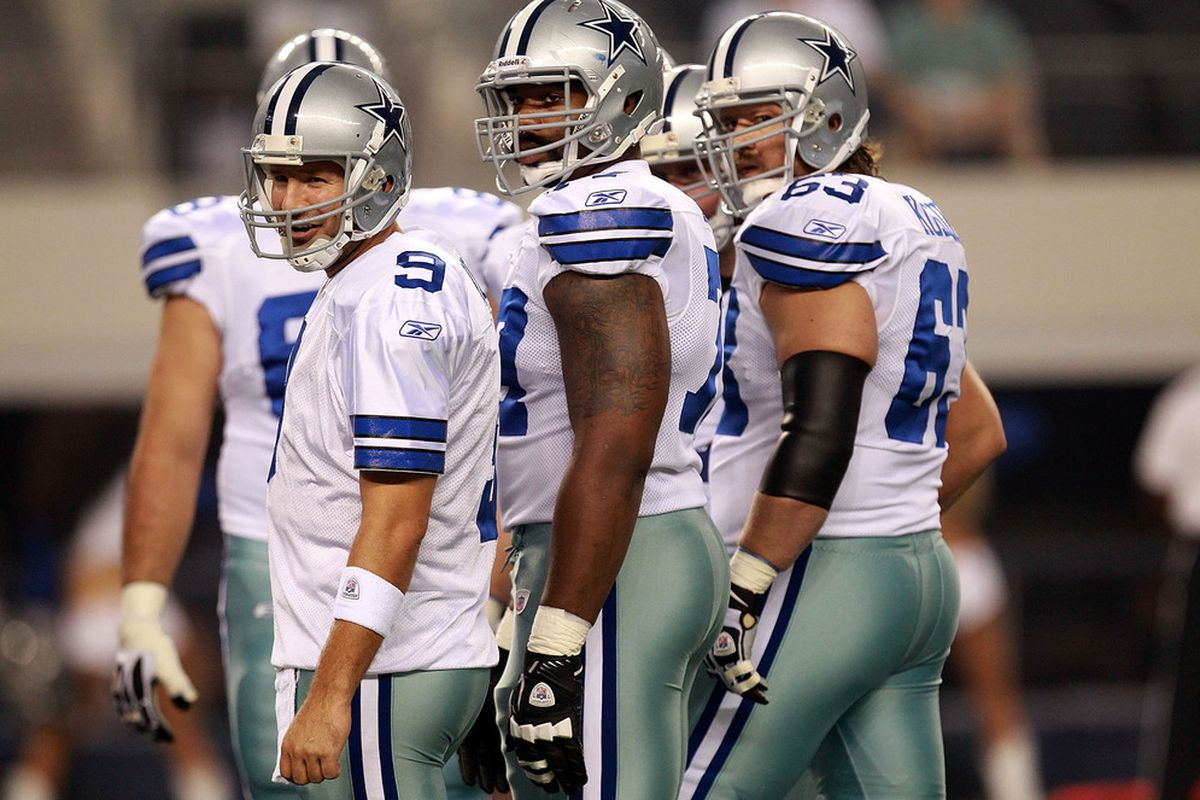 ARLINGTON, TX - AUGUST 11:  Tony Romo #9, Tyron Smith #77 and Kyle Kosier #63 of the Dallas Cowboys during a preseason game against the Denver Broncos at Cowboys Stadium on August 11, 2011 in Arlington, Texas.  (Photo by Ronald Martinez/Getty Images)