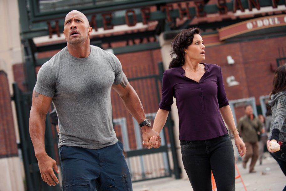 """Dwayne """"The Rock"""" Johnson and Carla Gugino in San Andreas."""