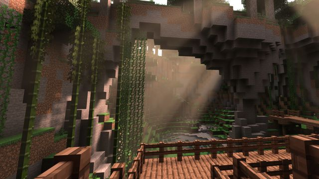 screenshot of a wooden boardwalk through a jungle environment in Minecraft, with ray tracing enabled, showing shafts of sunlight coming in through the canopy and shining on a waterfall in the background