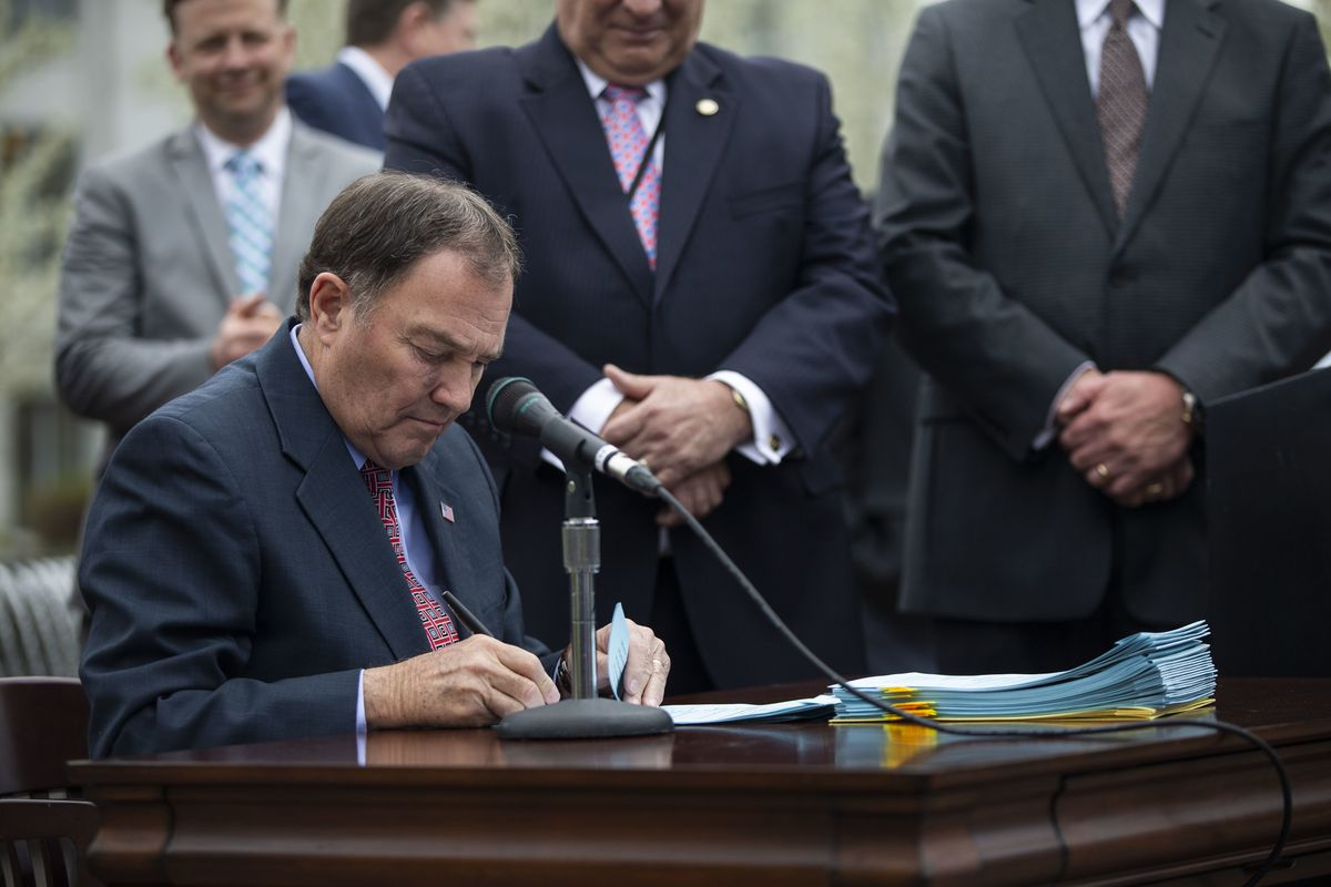 Gov. Gary Herbert ceremonially signs clean air legislation at the Capitol in Salt Lake City on Monday, April 22, 2019.