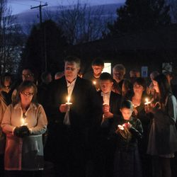 People hold candles during a vigil in support of John Dehlin, Sunday, Feb. 8, 2015, in North Logan, Utah.  A disciplinary council concerning Dehlin was held by The Church of Jesus Christ of Latter-day Saints.