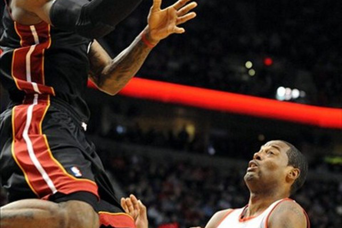 Mar. 1, 2012; Portland, OR, USA;  Miami Heat small forward LeBron James (6) drives to the basket past Portland Trail Blazers center Marcus Camby (23) during the first quarter of the game at the Rose Garden. Mandatory Credit: Steve Dykes-US PRESSWIRE