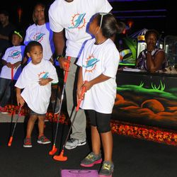 Marcus Thigpen with students from Henry S. Reeves Elementary at Monster Mini Golf in Miramar