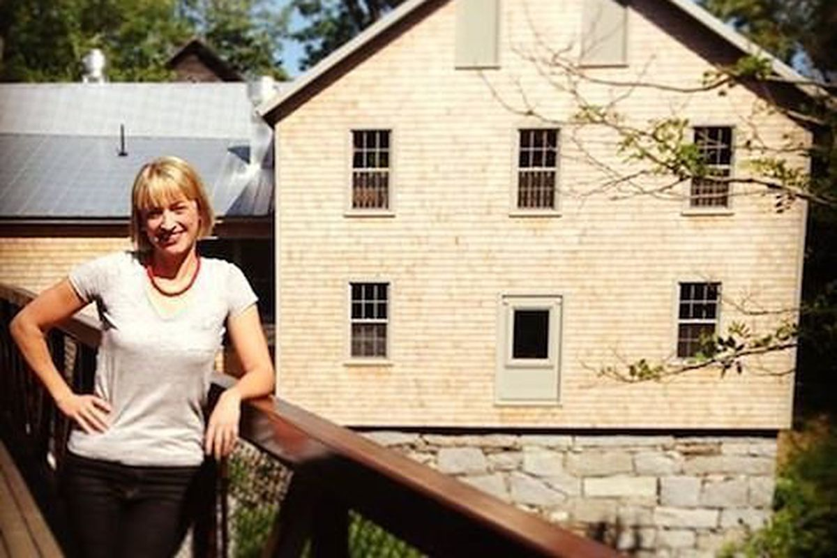 Owner Erin French in front of The Mill at Freedom Falls.